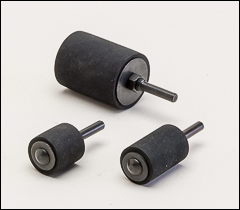 Rubber drums for abrasive sleeves